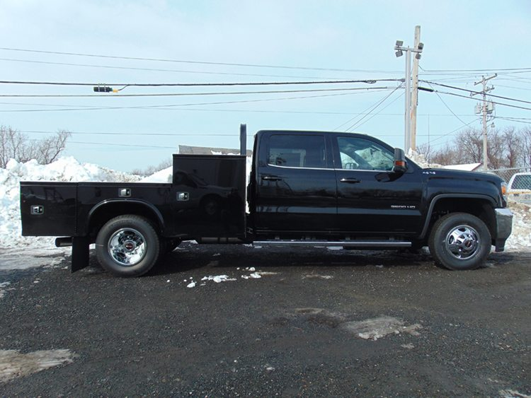 Black truck with gooseneck on snowy background